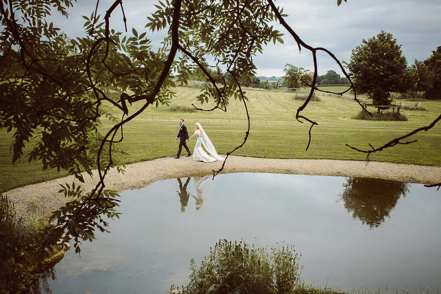 Bride and groom reflection wedding photo